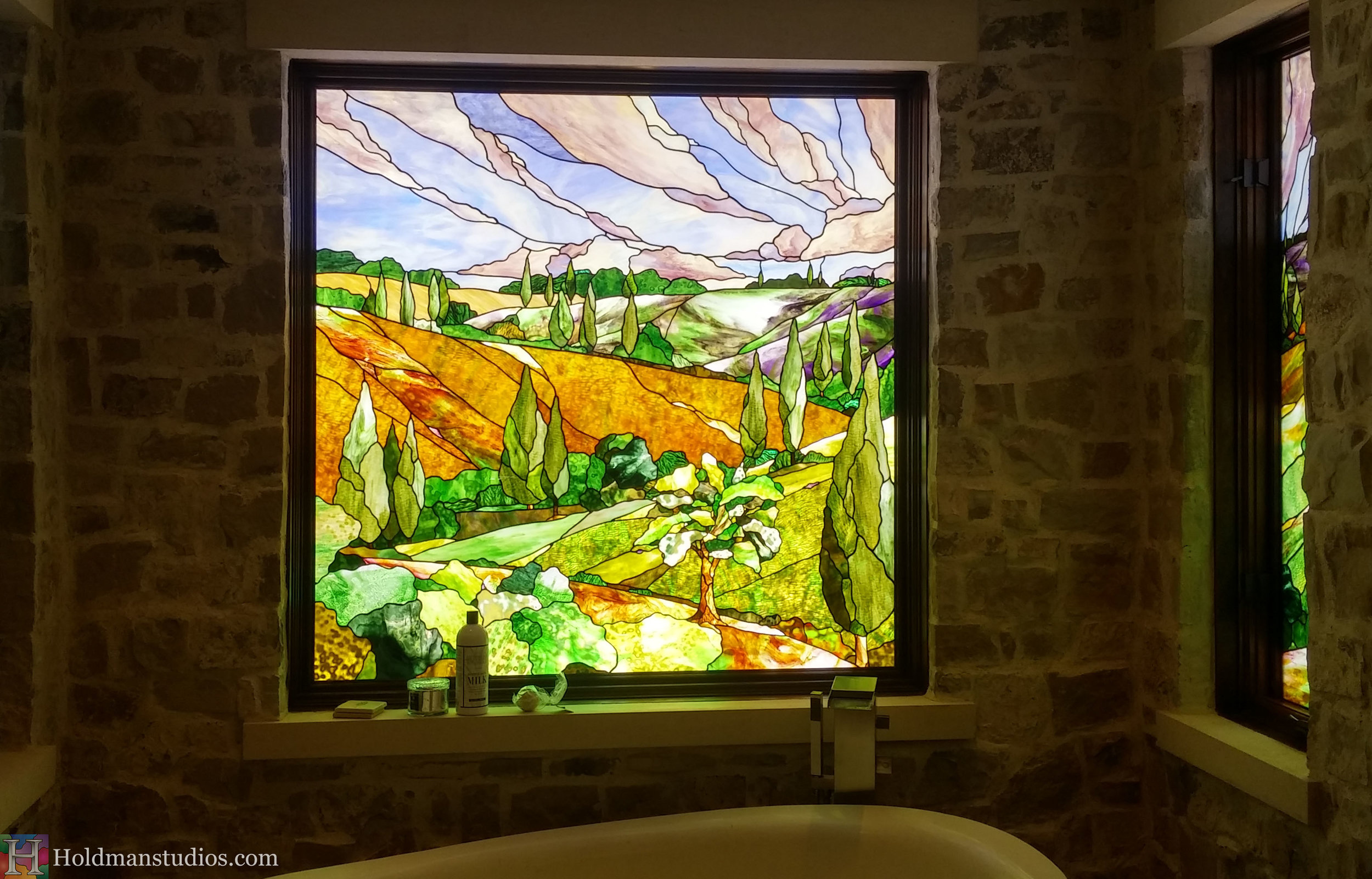 Holdman-Studios-Stained-Glass-Bathroom-Window-Landscapes-Trees-Bushes-Hills-Sky-Clouds-.jpg