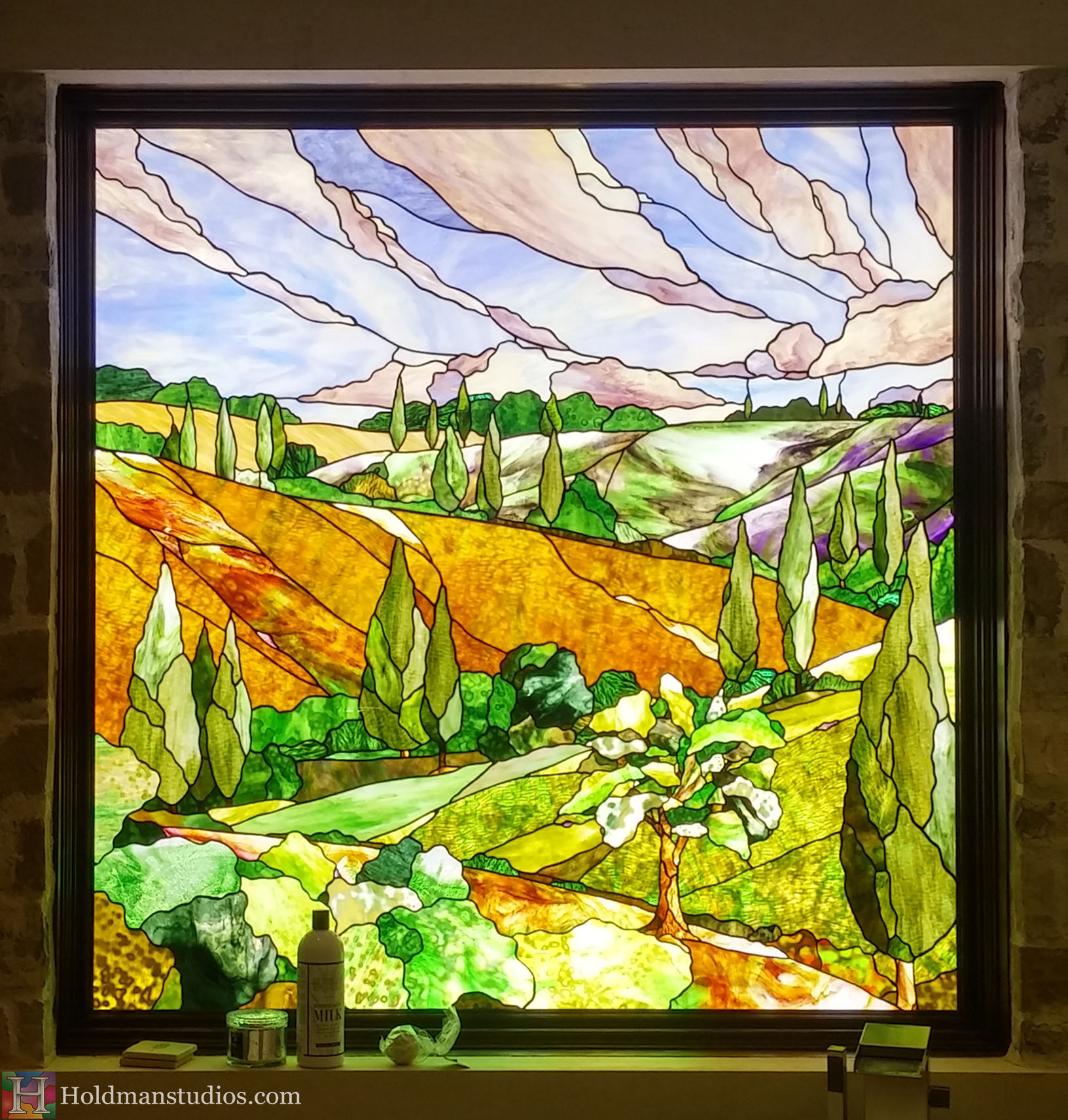 Holdman-Studios-Stained-Glass-Bathroom-Window-Landscapes-Trees-Bushes-Hills-Sky-Clouds-Crop.jpg