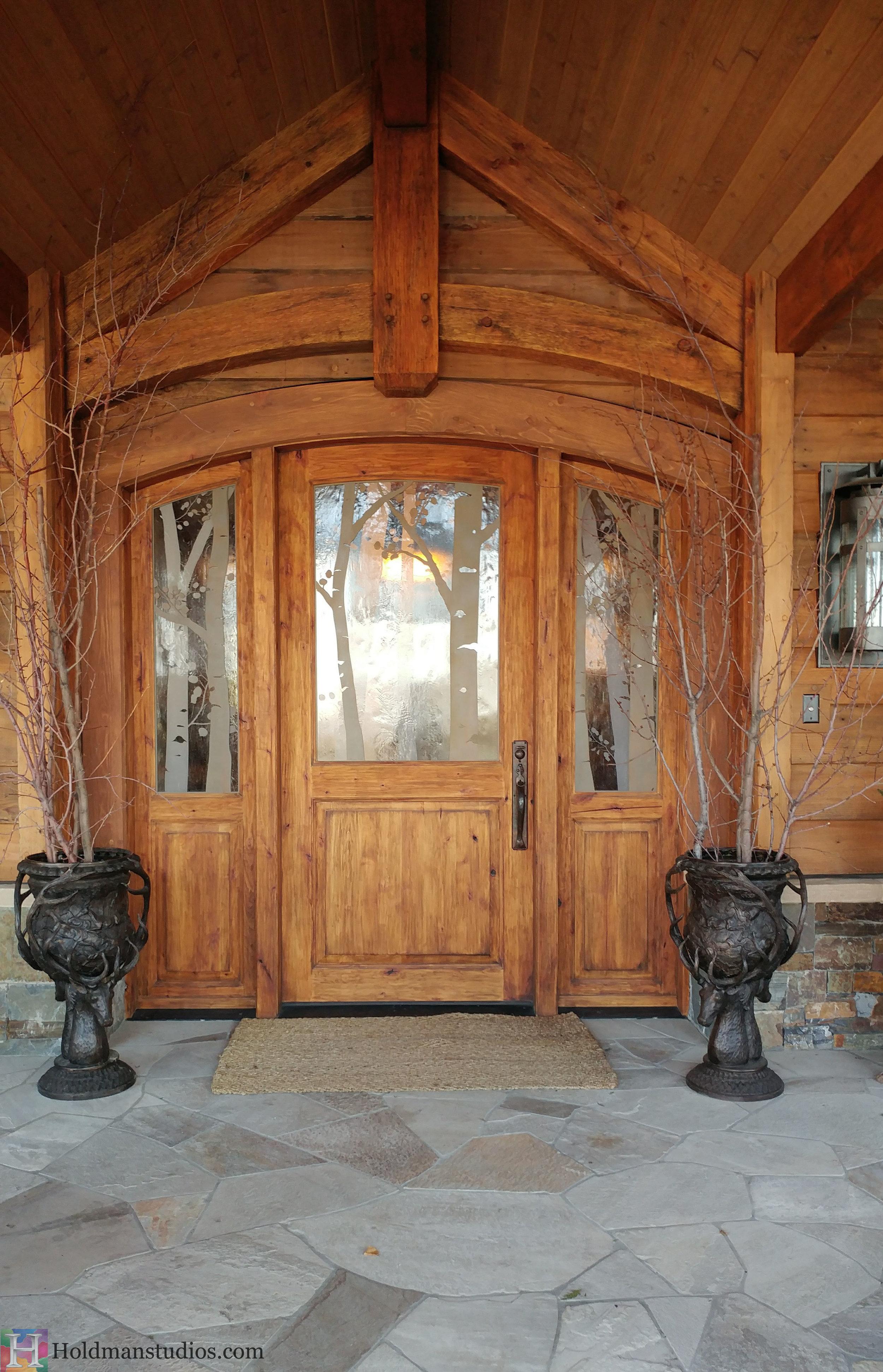 Holdman-studios-etched-art-glass-front-door-windows-aspen-trees-leaves-outside.jpg