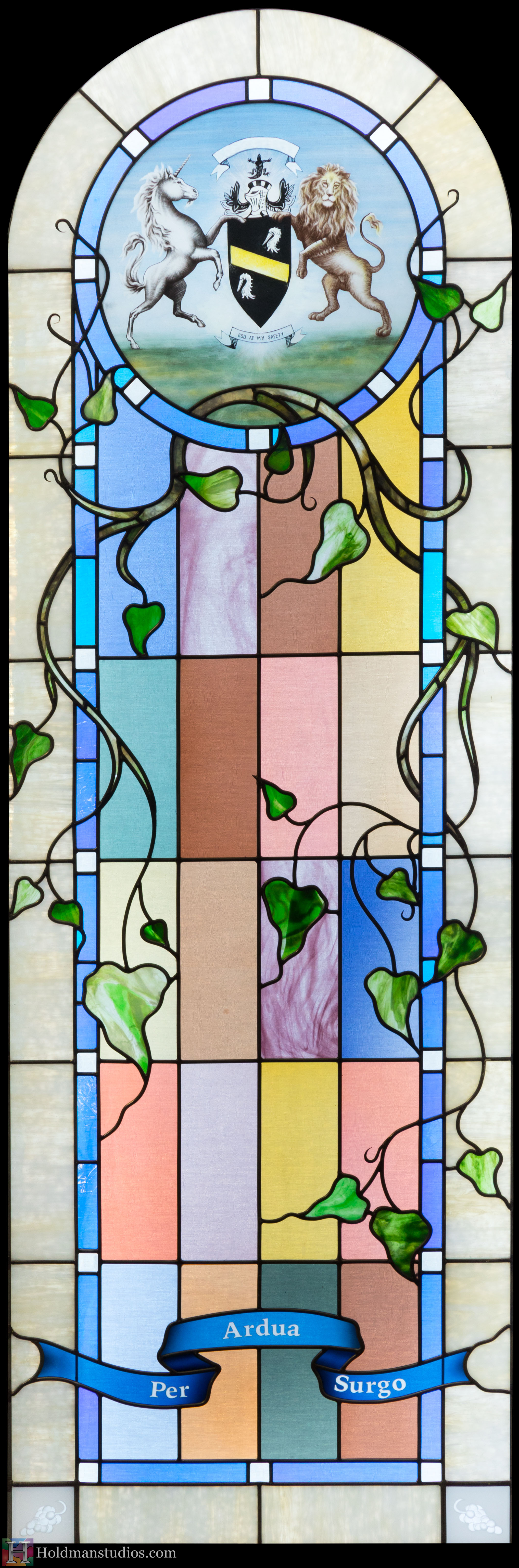 Holdman-studios-stained-glass-study-window-per-ardus-surgo-vine-leaves-plants-lion-unicorn-coat-of-arms-closeup.jpg