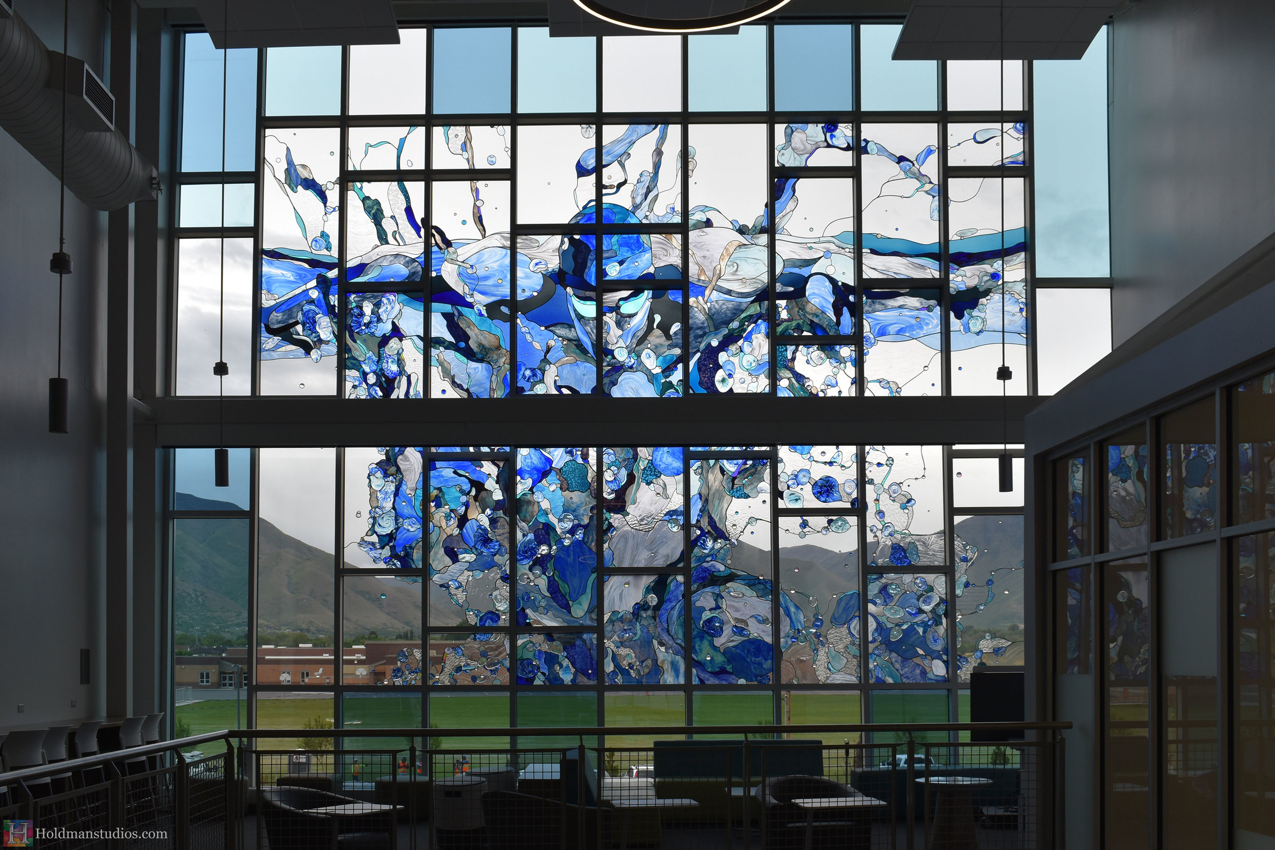 holdman-studios-hand-blown-stained-glass-window-springville-clyde-rec-center-slash-and-wave.jpg