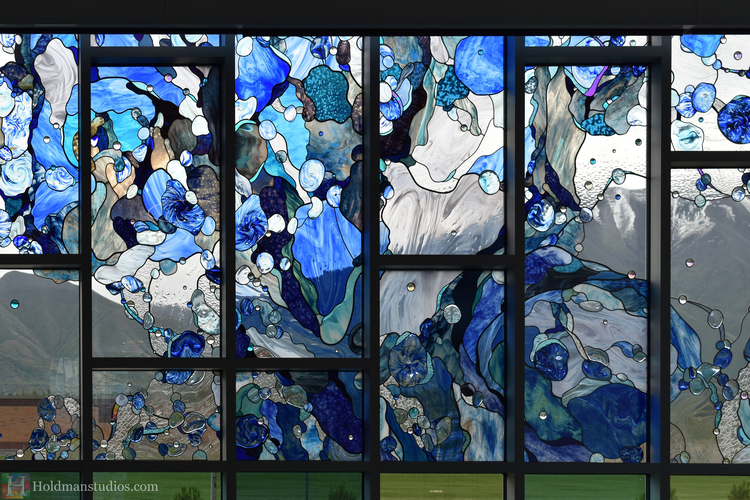 holdman-studios-hand-blown-stained-glass-window-springville-clyde-rec-center-slash-and-wave-crop.jpg