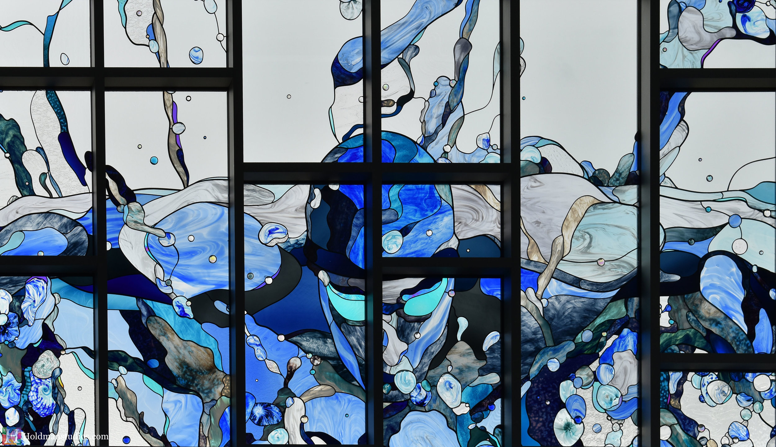 holdman-studios-hand-blown-stained-glass-window-springville-clyde-rec-center-slash-and-wave-swimmer-crop.jpg