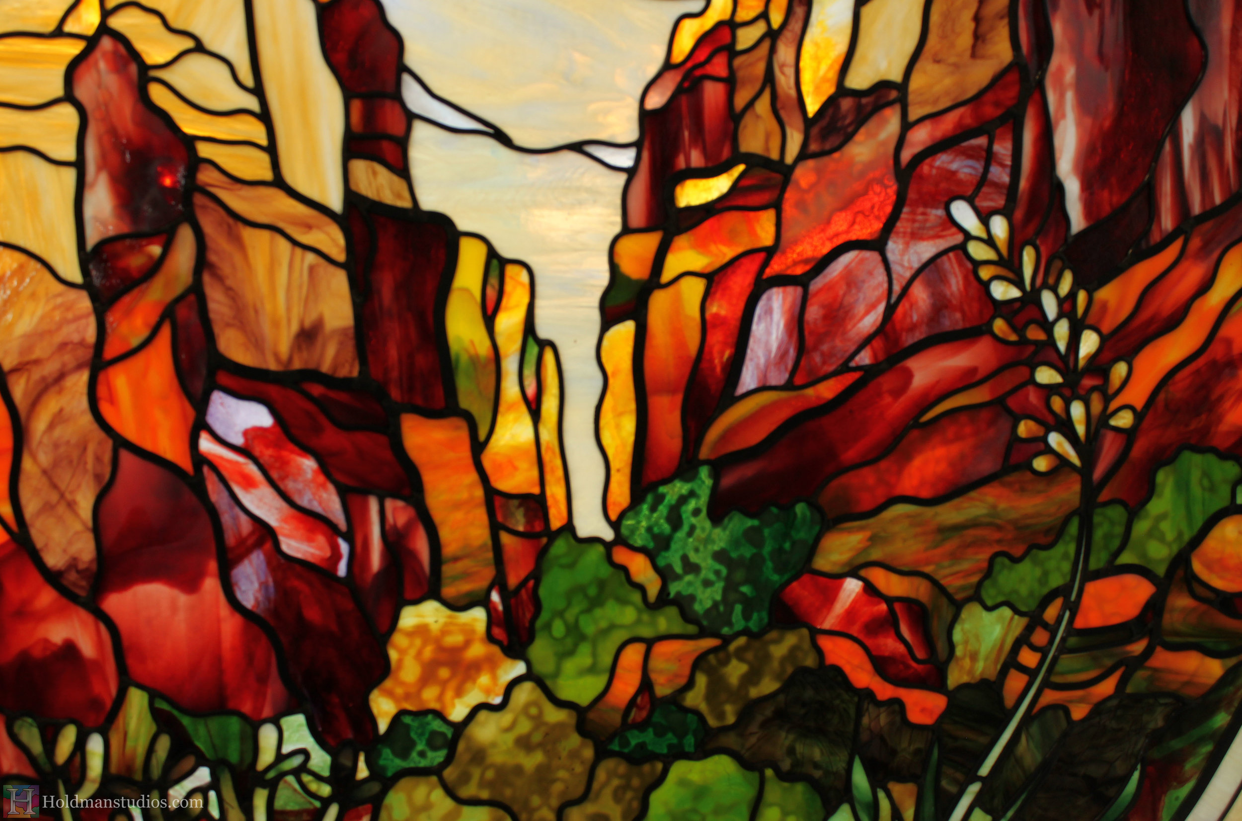 holdman-studios-st-george-airport-stained-glass-window-red-rock-mountains-flowers-plants.jpg