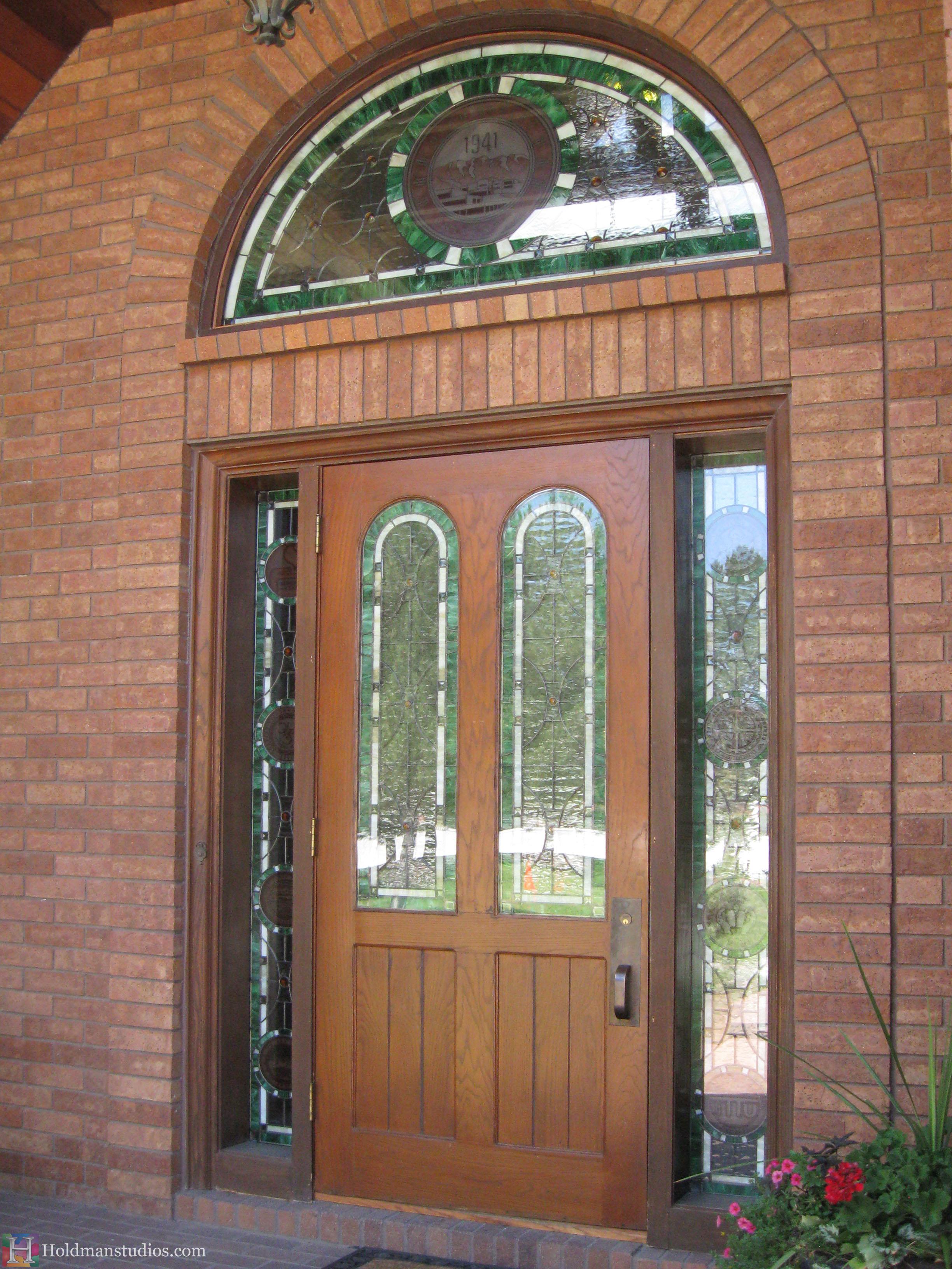 Holdman-studios-stained-glass-front-door-sidelight-transom-windows-utah-valley-university-alumni-house-outside-view.jpg