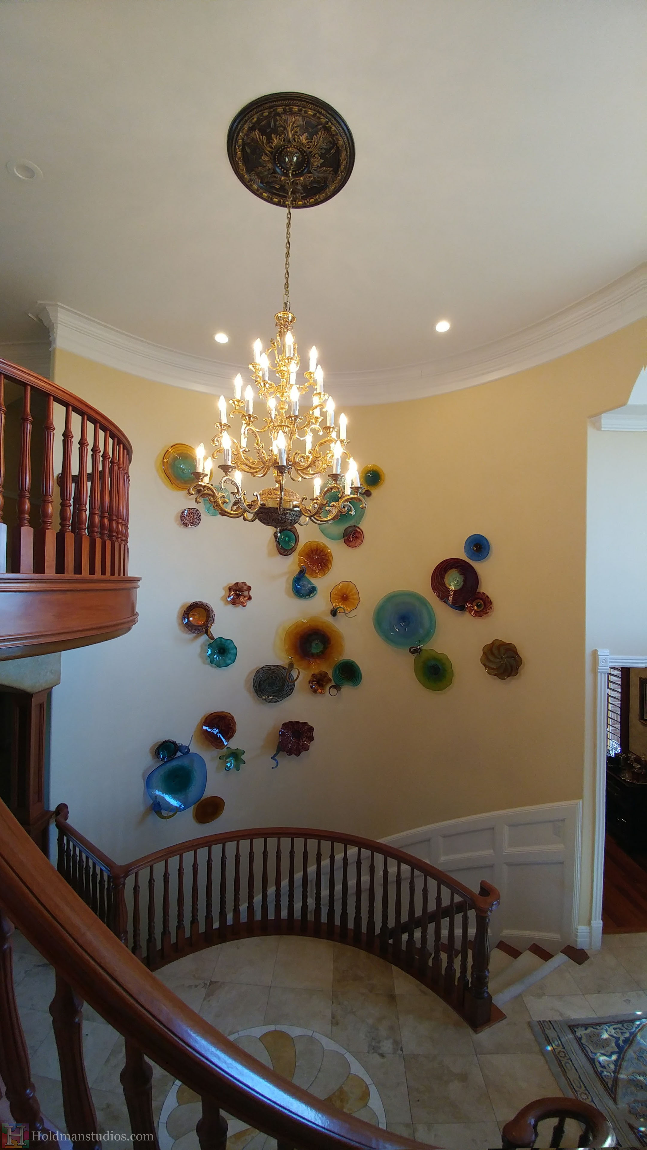holdman-studios-hand-blown-glass-platter-bowls-tendrils-stair-wall-display.jpg