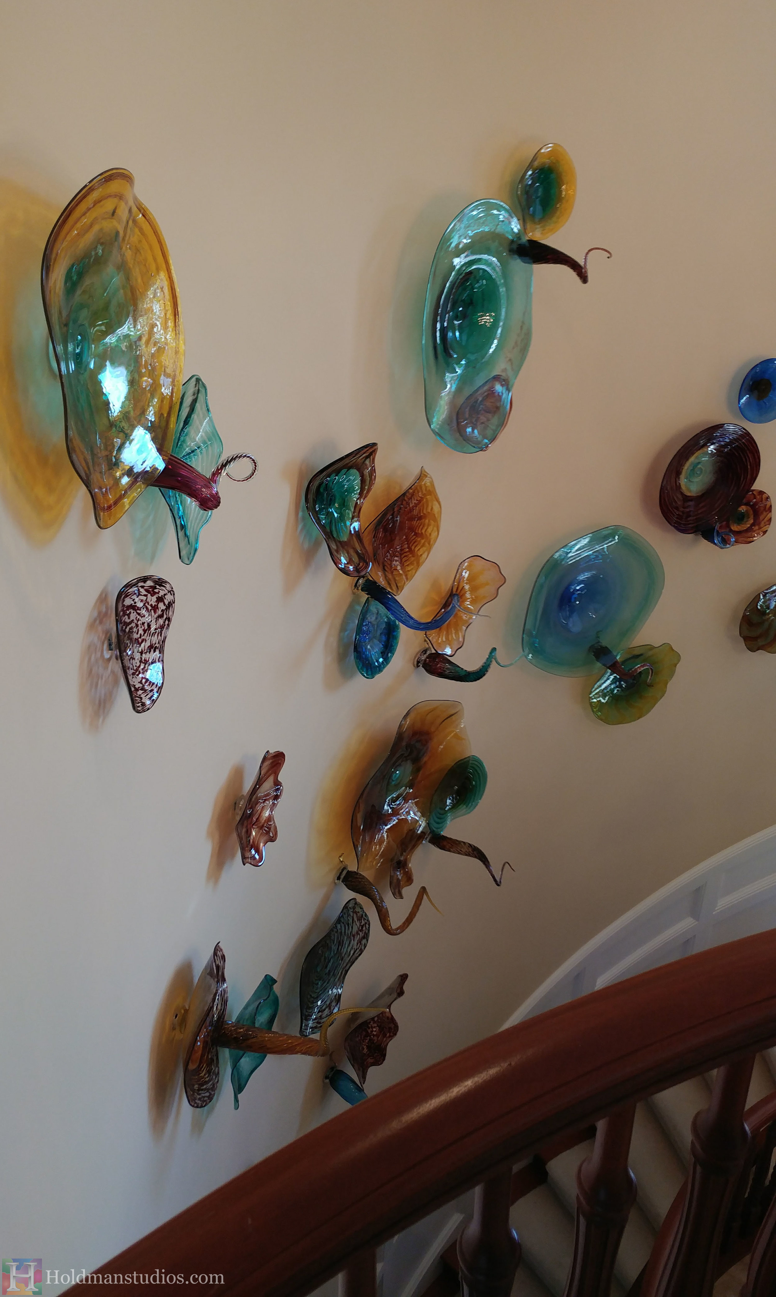 holdman-studios-hand-blown-glass-platters-bowls-tendrils-stair-wall-display-sideview.jpg