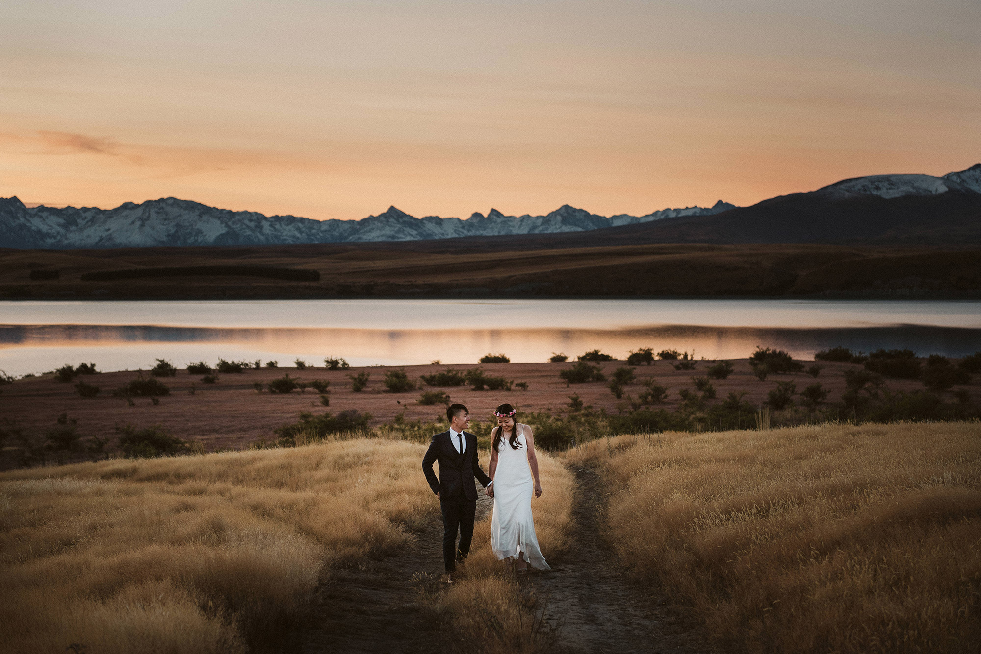 LAKE TEKAPO  A great starting or finishing point for a full day pre-wedding session. Known for its rugged beauty, clear blue waters and epic lupin fields, Lake Tekapo ticks all the boxes for the perfect pre-wedding session.