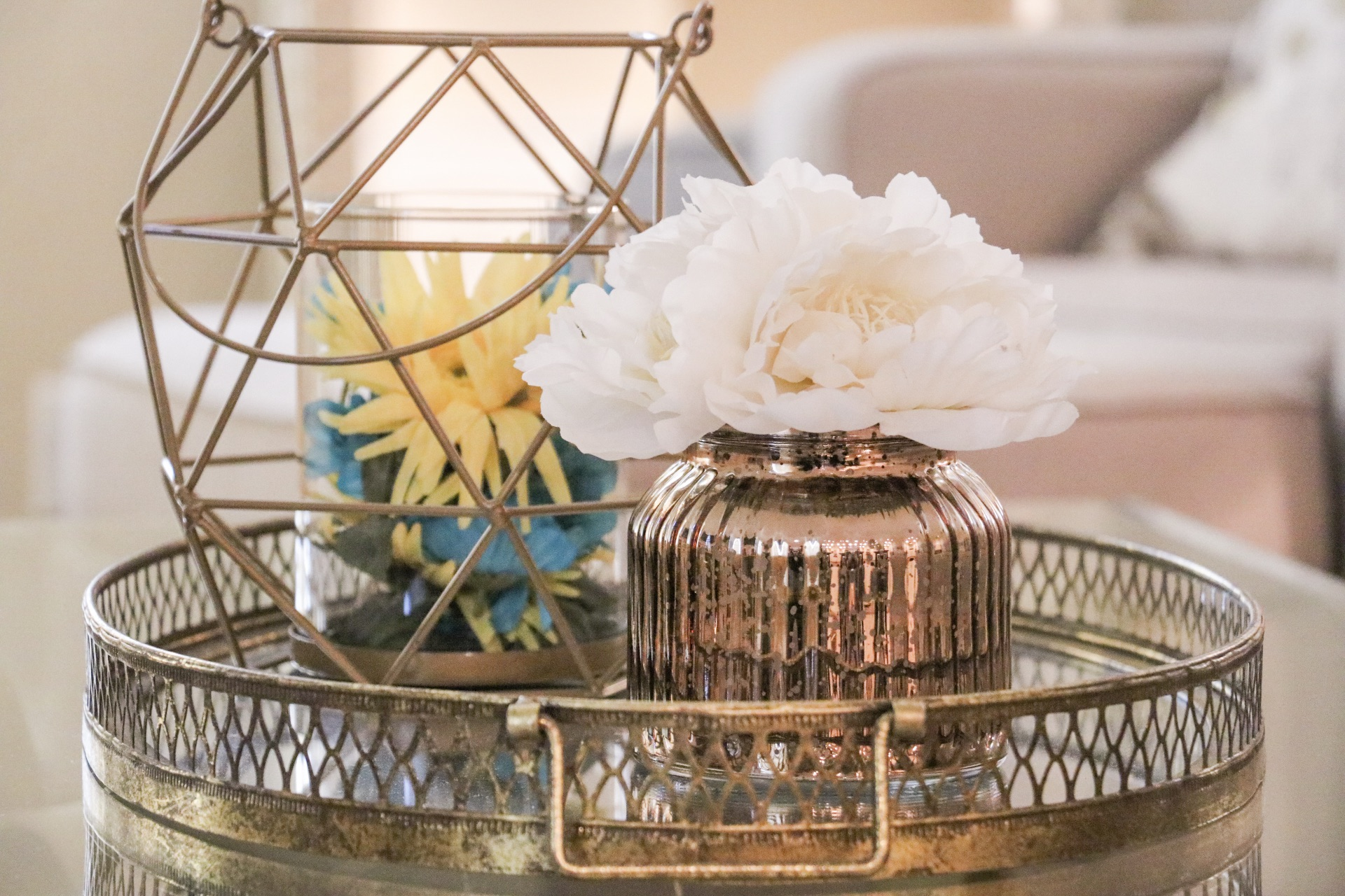 I love our center piece on this coffee table! All of it is from Kirklands and I just put some fake flowers in the candle holder to brighten up and bring some color in the room!