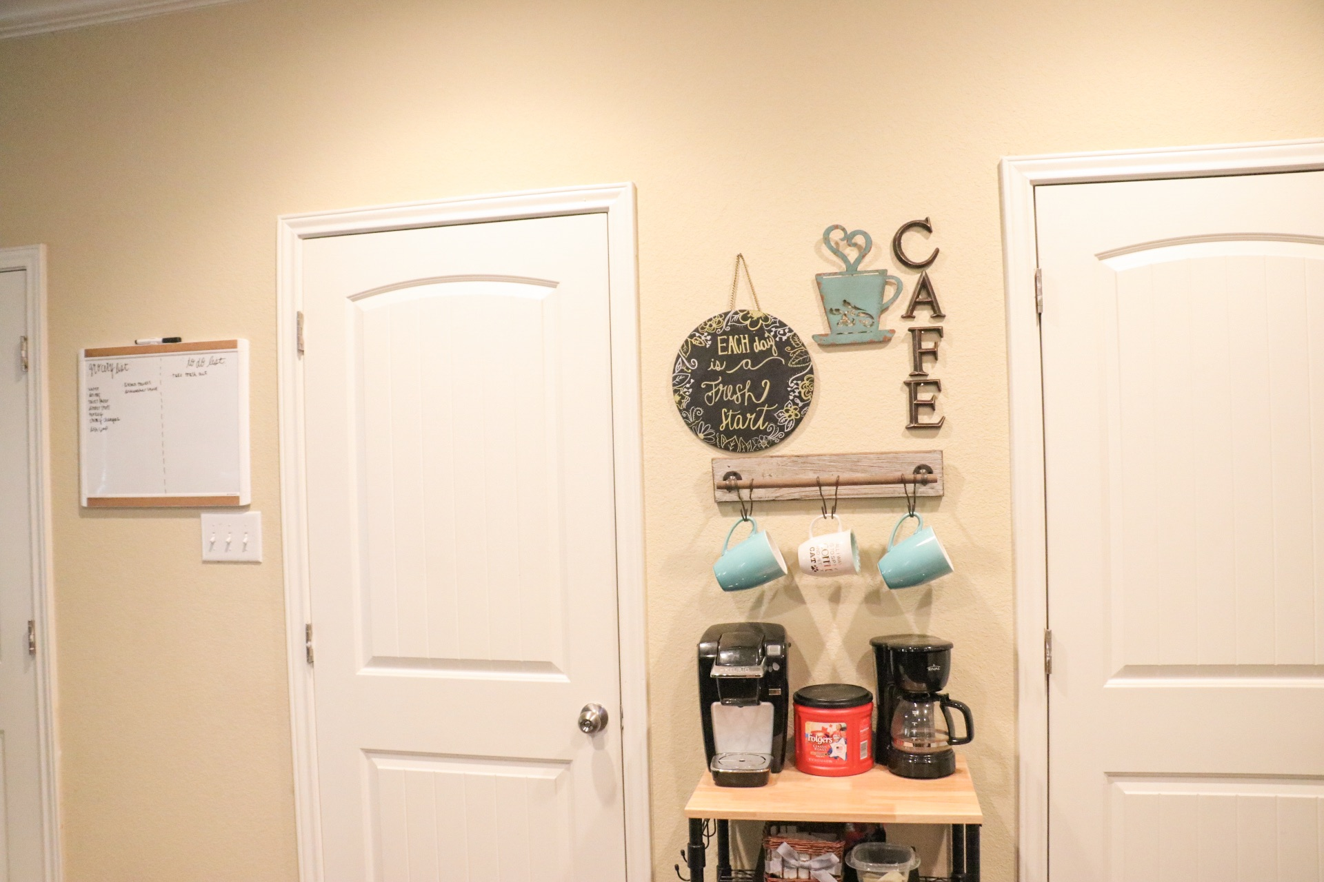 In our kitchen area, we made this cute little coffee bar! We got the stand from WalMart, the coffee cup holder from Hobby Lobby, the chalkboard from Target and the cafe and coffee decor from Hobby Lobby!