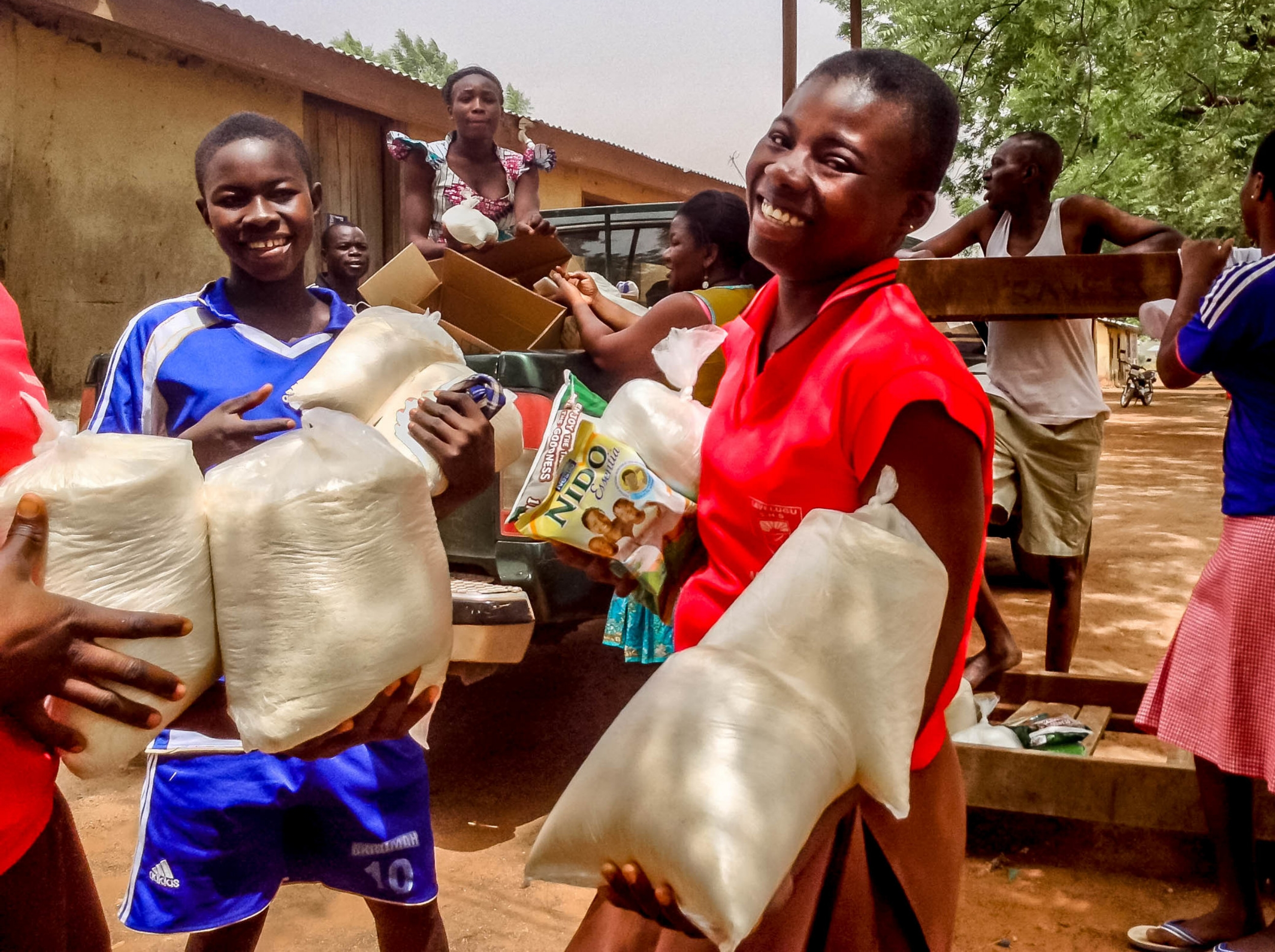 Girl smile nicely after receiving their her supply.jpg
