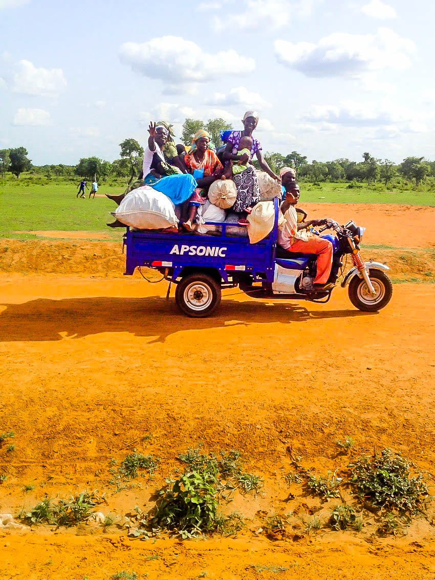 A photo of people who loaded lots of items on motor bike from Kpundulli to Tamale-2.jpg