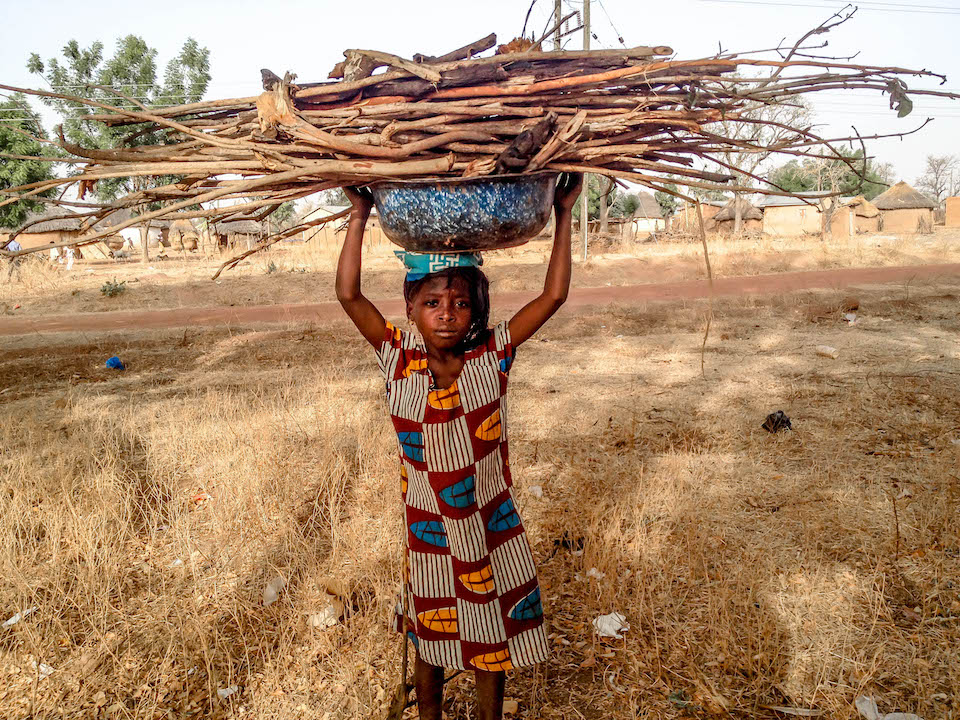 shakira carrying firewood she fetched from the bush.jpg