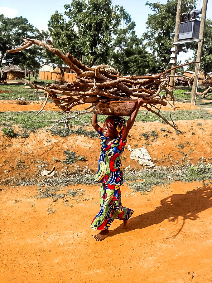 Warihana a class 2 student carring a load of firewood home after reading club.jpg