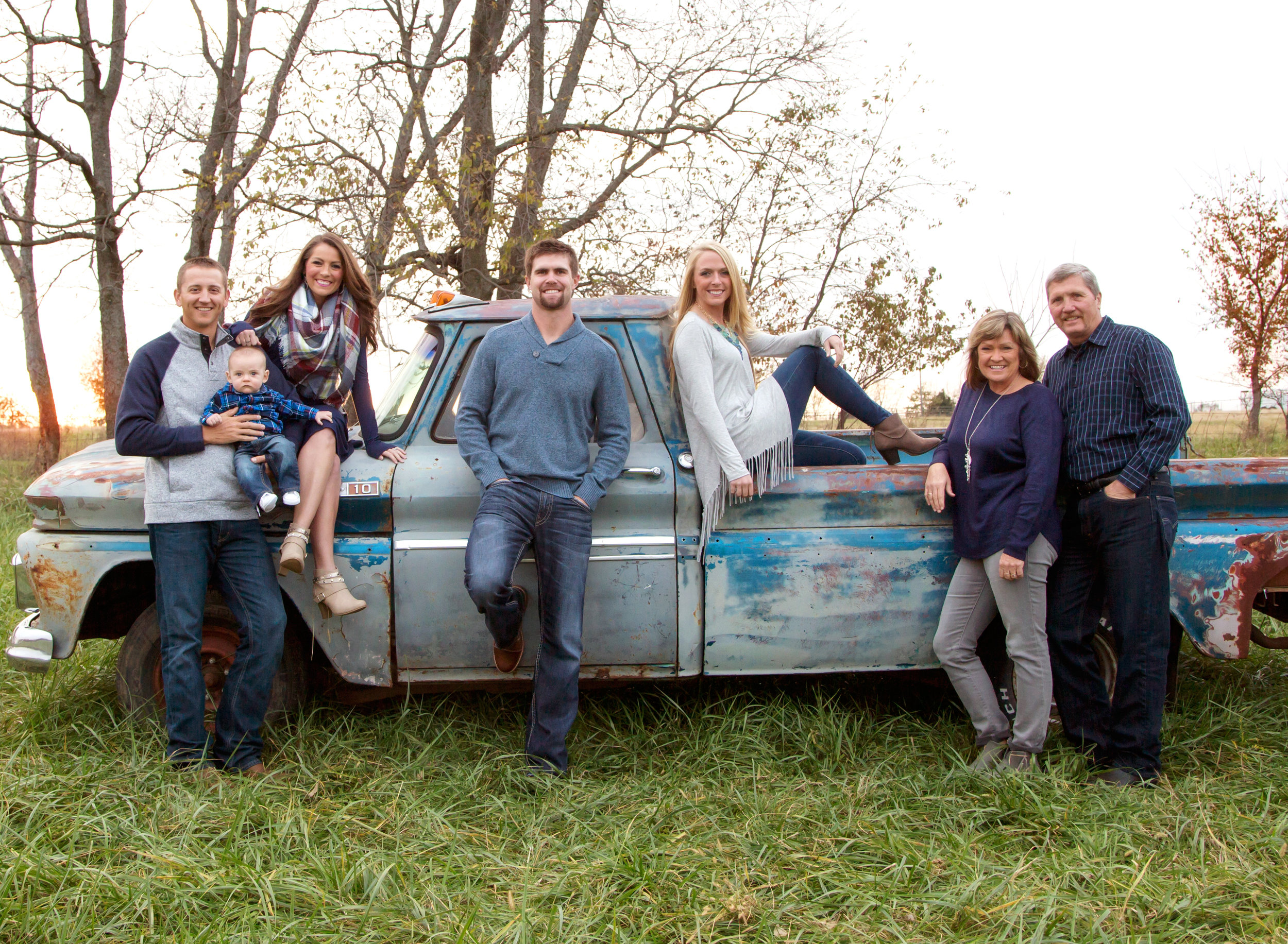 vintage truck family photos - large family photos - kansas city family pictures - kansas city photographer - best family photos - pictures in johnson county kansas - large family with chevy truck - outdoor fall family photos