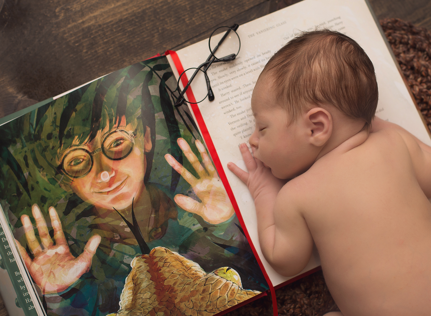new baby laying on harry potter book