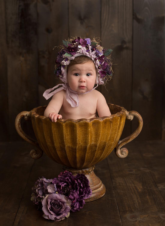kansas city baby photographer, baby in flower bonnet, adorable baby girl