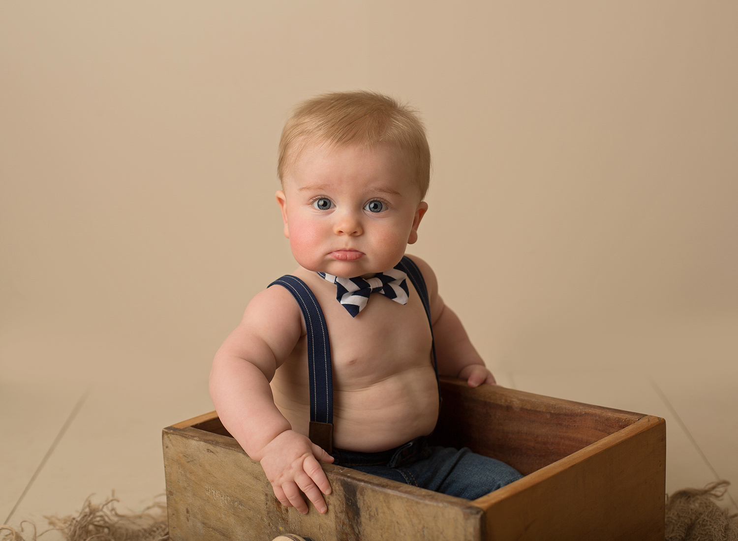 cute baby boy wearing bow tie sitting up pictures blue eyes kansas city baby photographer