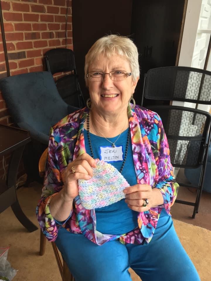 Jeri Melton proudly displays her handiwork.