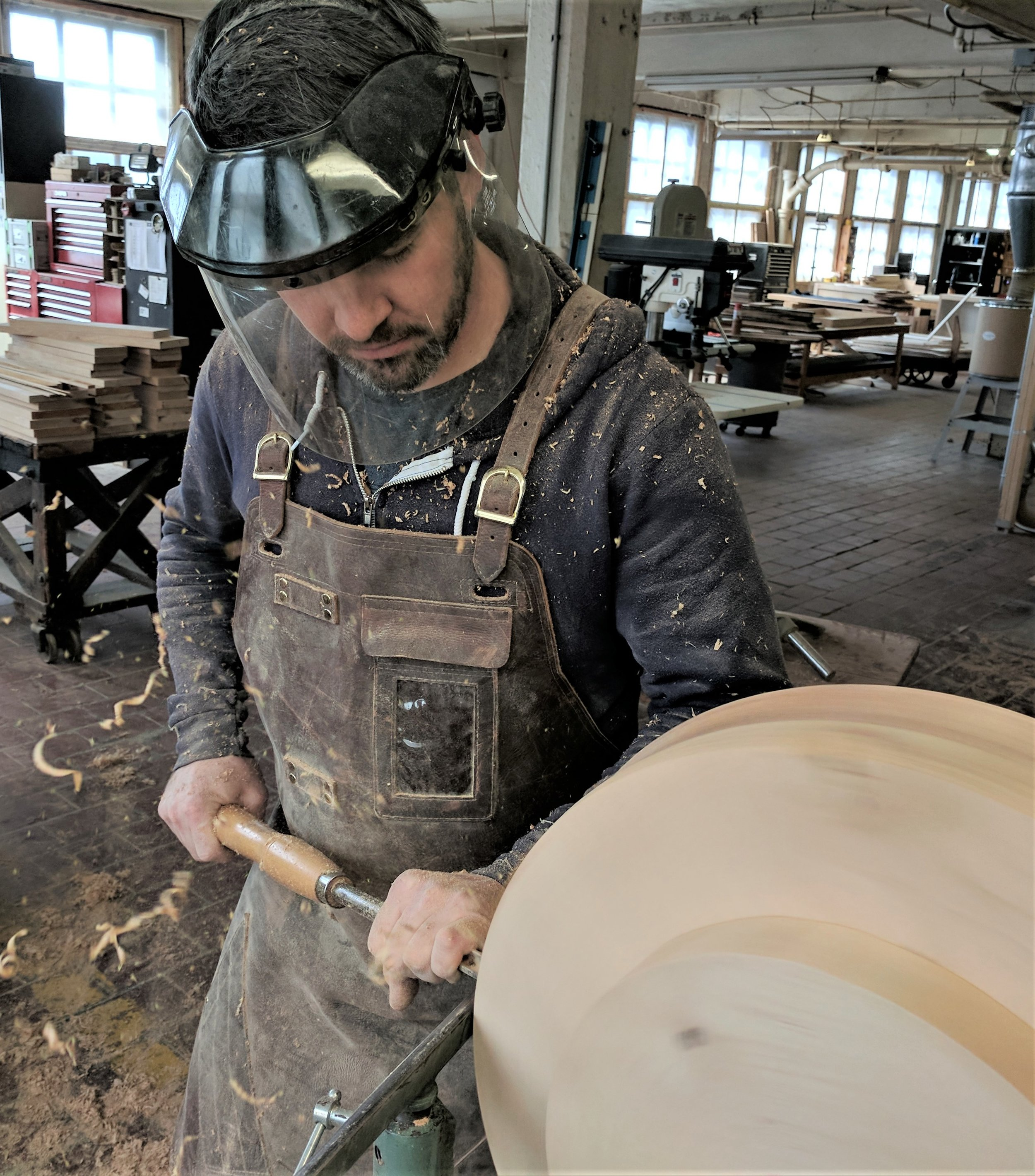 Robert hand-turning a pedestal table base for Borrow Curated: Rentals, Retail & Venue