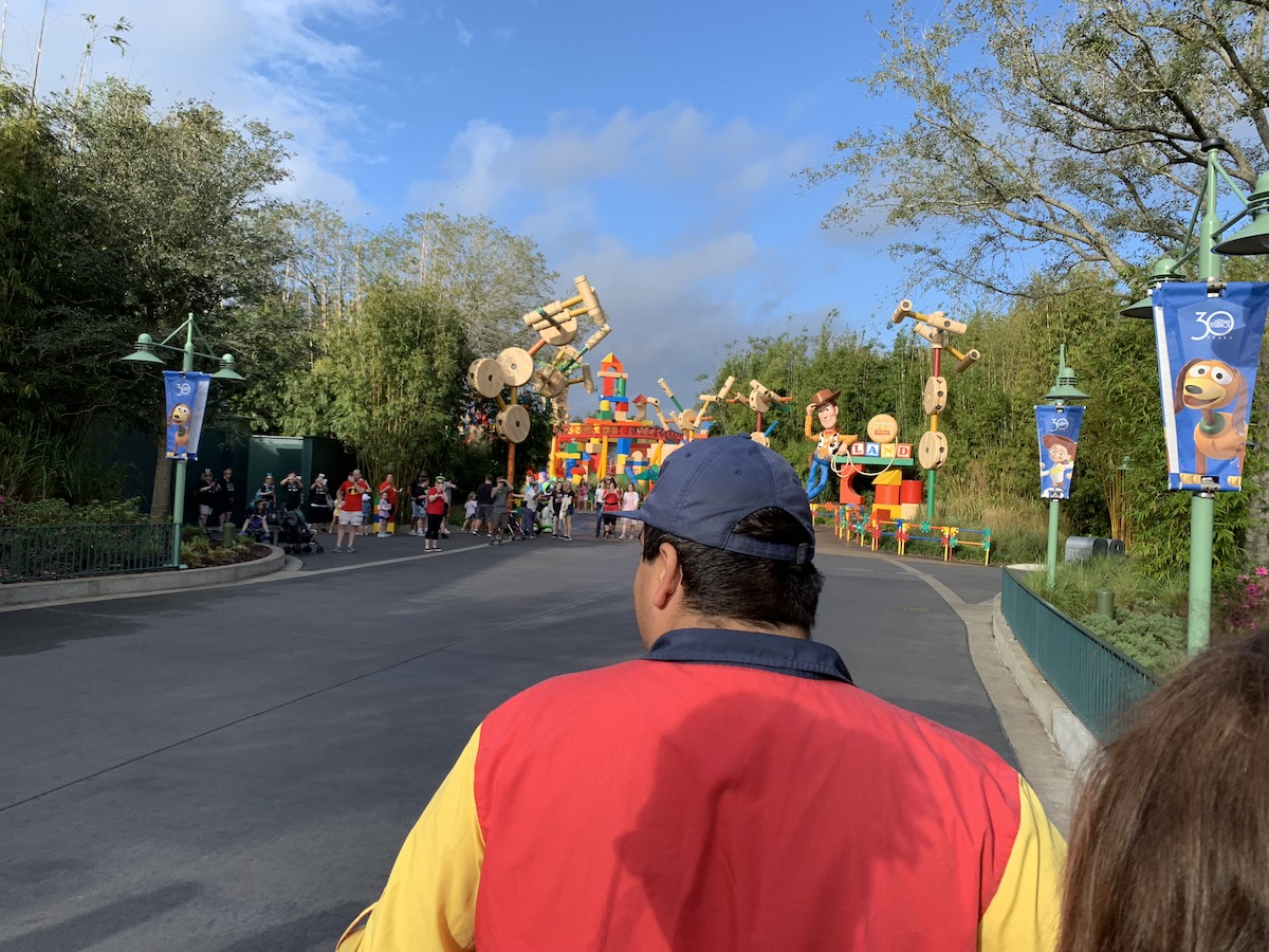 Guests with Early Morning Magic (left) are happier to take pictures of rope drop than to participate in it.