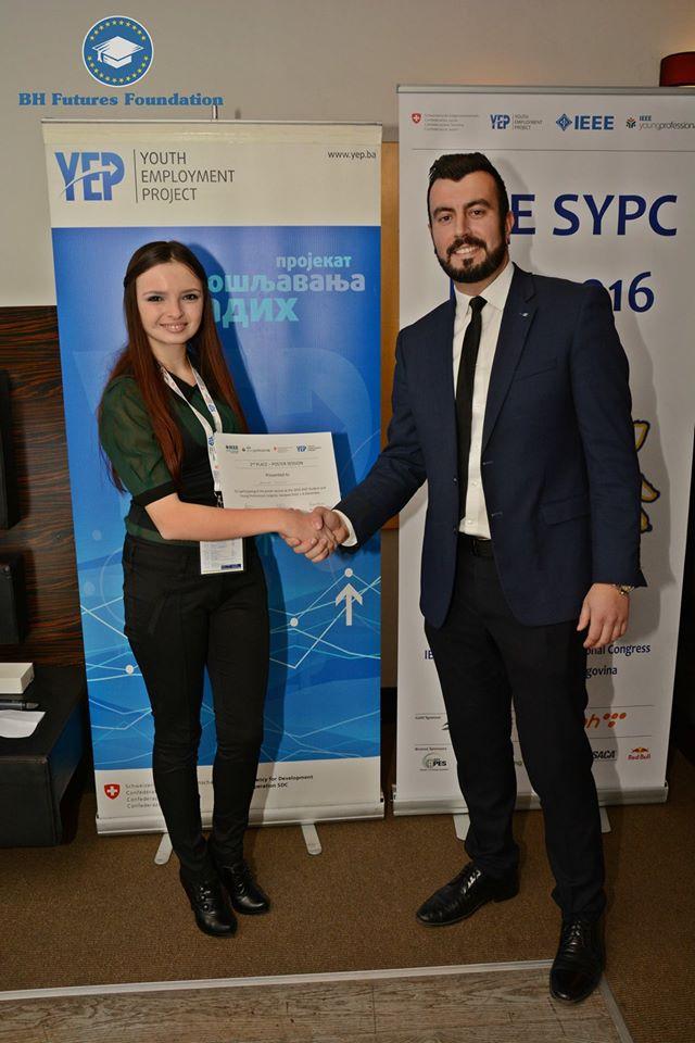 Jasna Nuhic receiving the award from the Bosnia & Herzegovina Futures Foundation Founder & Chair, Dr. Edhem (Eddie) Custovic