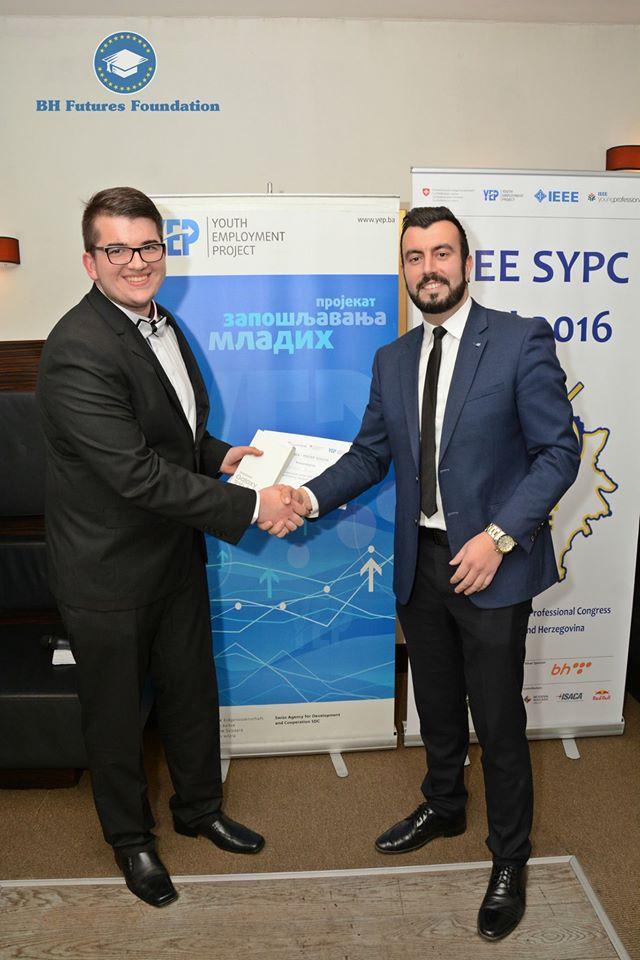 Dalibor Djumic receiving the 1st place award from Bosnia & Herzegovina Futures Foundation Founder & Chair Dr. Edhem (Eddie) Custovic.