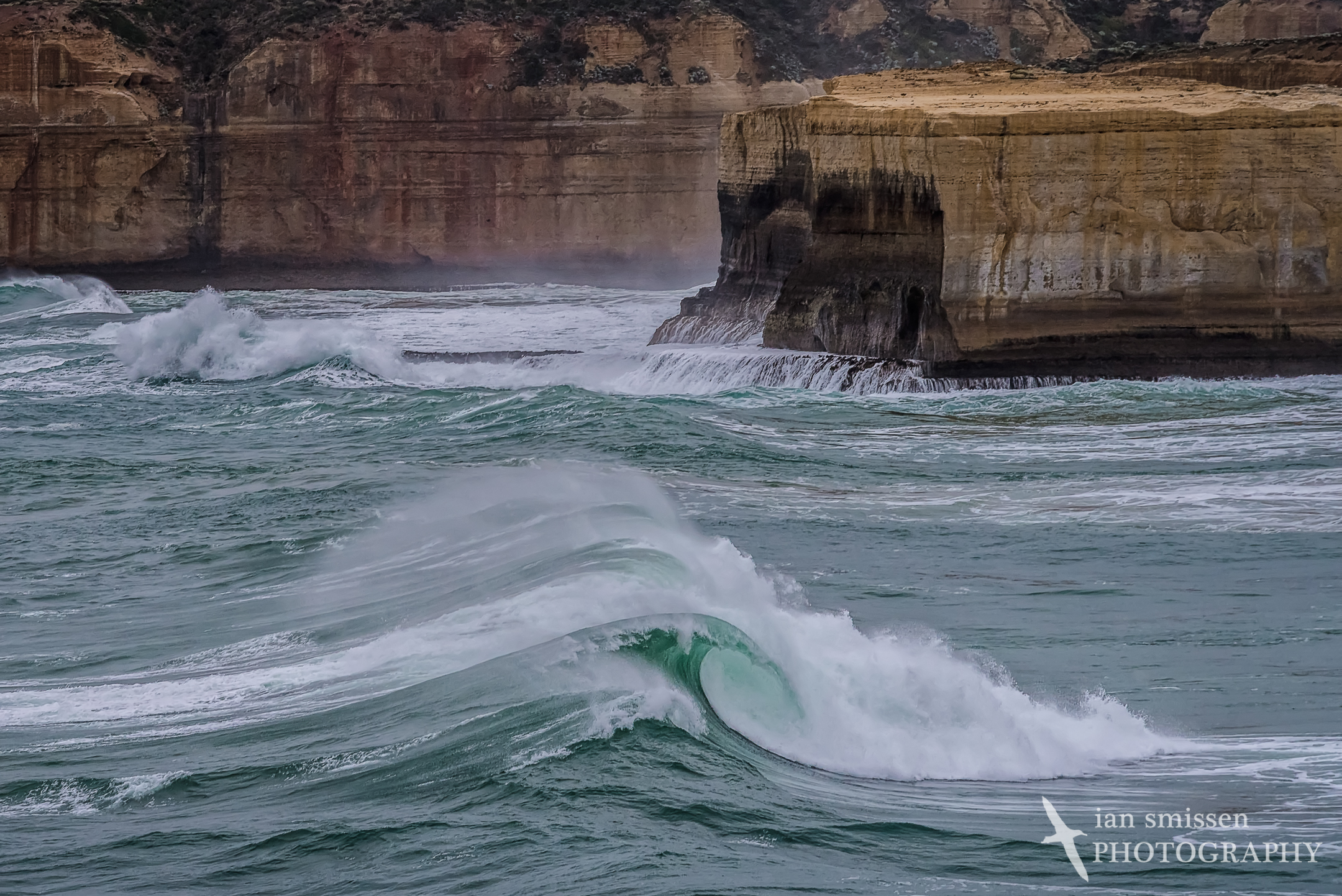 Wave and cliffs viewed from Broken Head
