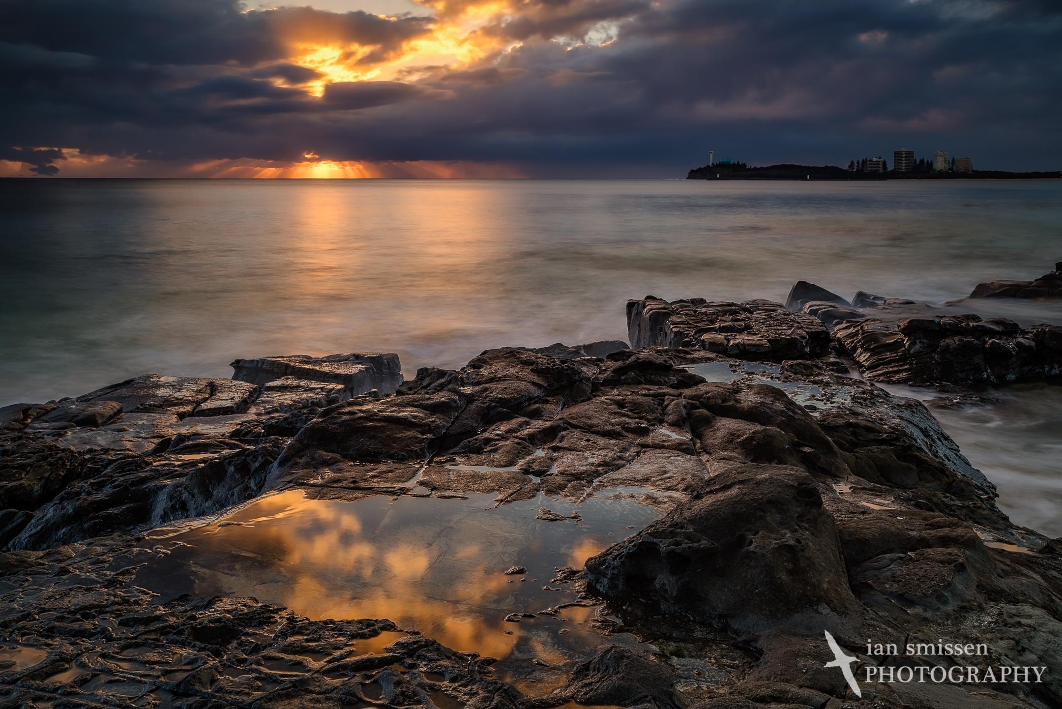 Sunrise on rock pools at Mooloolaba Beach