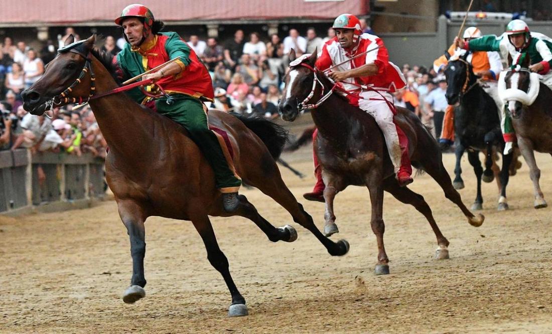 The winning Contrada (horse) known as 'Drago' ridden by Andrea Mari (Vincento Pinto/AFP)