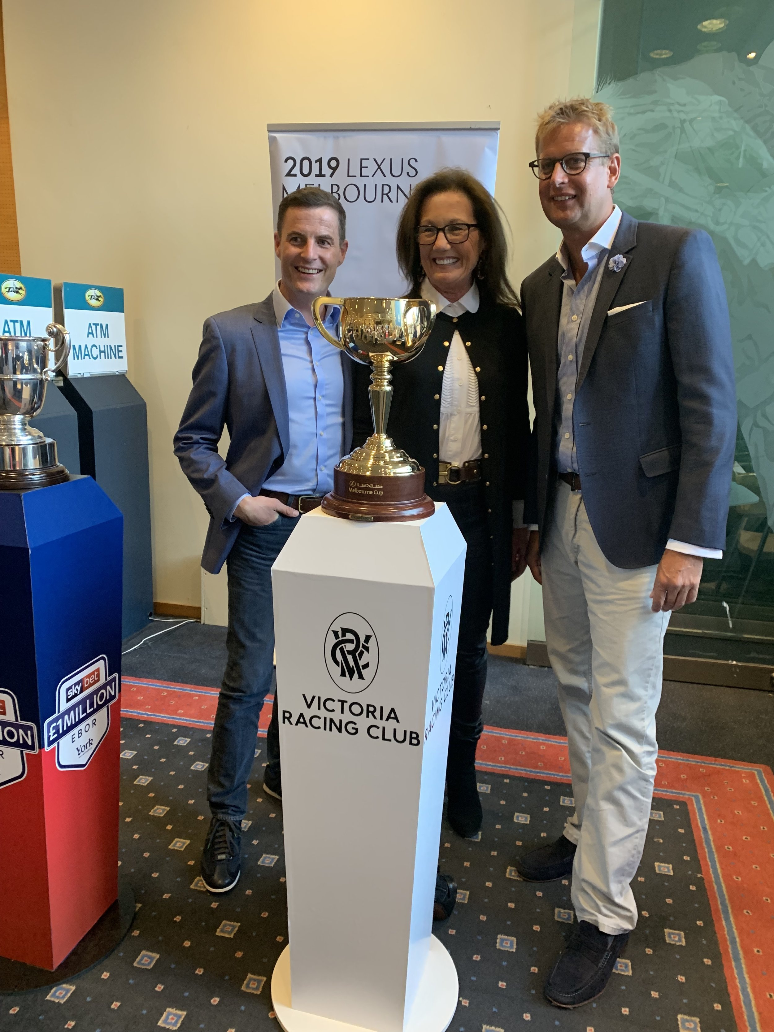 Fran Berry and Ed Chamberlin with the Melbourne Cup