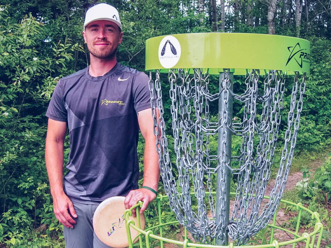 Scott Gerdes Cale Leiviska stand next to one of the state-of-the-art disc golf baskets one the Painted Turtle course he designed for the City of Mountain Iron at the West Two Rivers Reservoir campground.