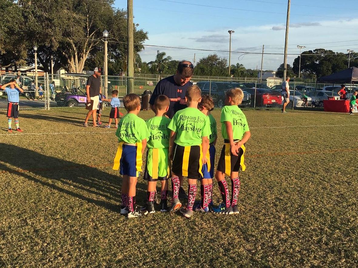 Tom coaching youth sports