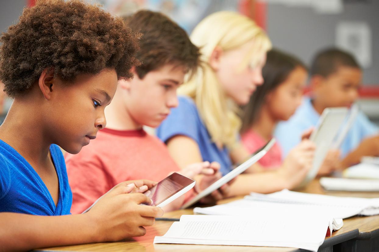 bigstock-Pupils-In-Class-Using-Digital--46599529.jpg