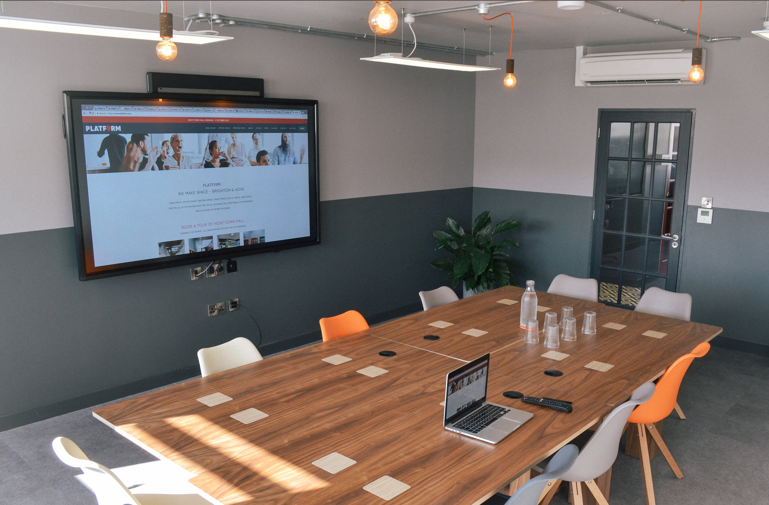 """14 person boardroom with HDMI connections and 86"""" interactive screen"""