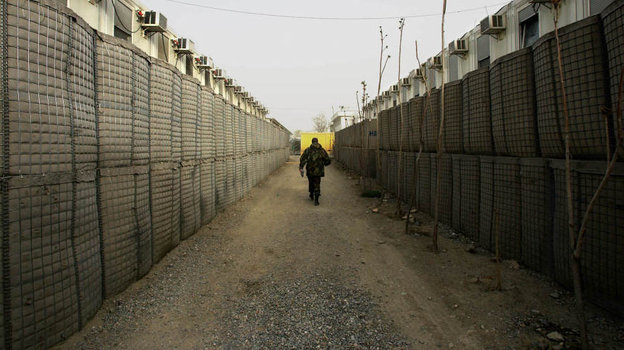 """In Afghanistan, """"HESCO Barriers"""" line corridors protected by sand barriers thick enough to withstand the impact of a car bomb. Source: NPR."""