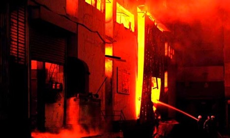 Firefighters trying to control a blaze at a garment factory in Karachi, Pakistan, which killed 314, and injured more than 600 people.  PHOTO: AFP