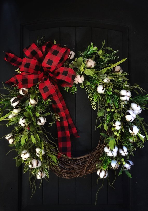 This  cotton wreath  from Etsy is one of my favorites. I love the white against my dark door and the buffalo plaid ribbon matches what I already have.