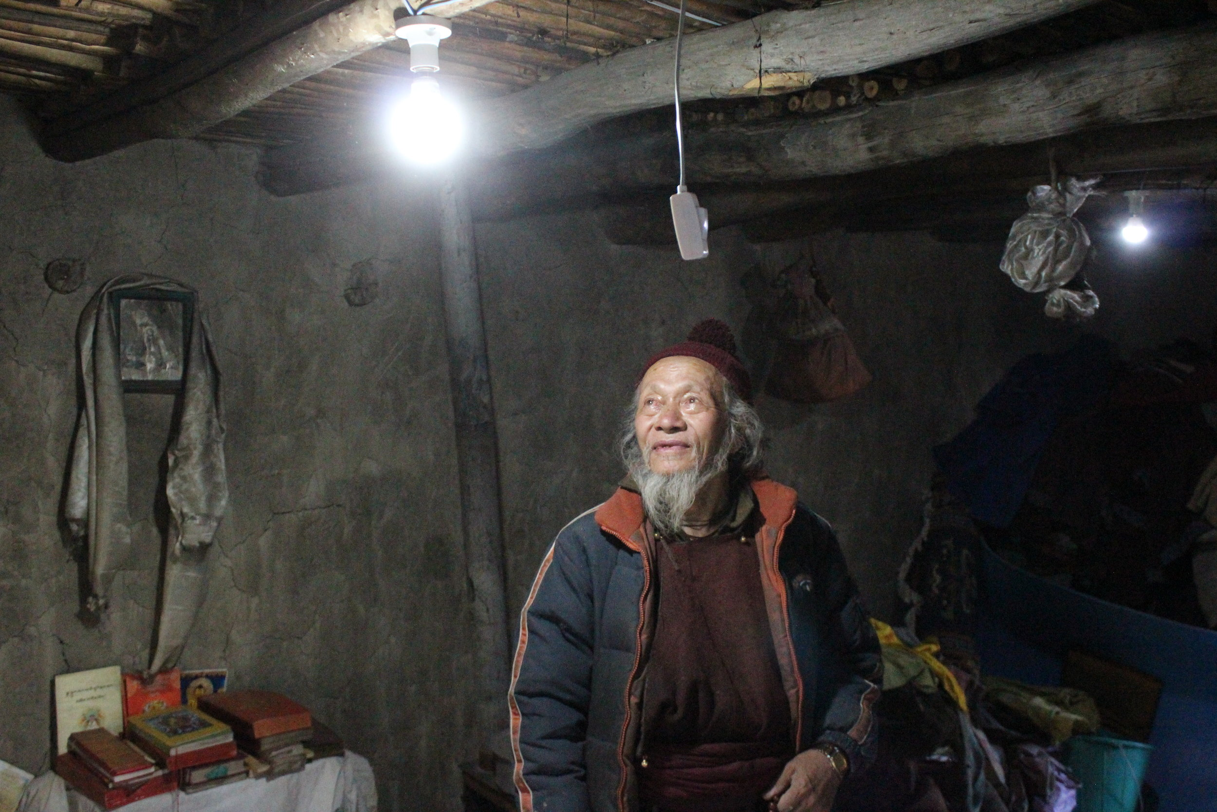 Villager in Machu experiencing electric light for first time