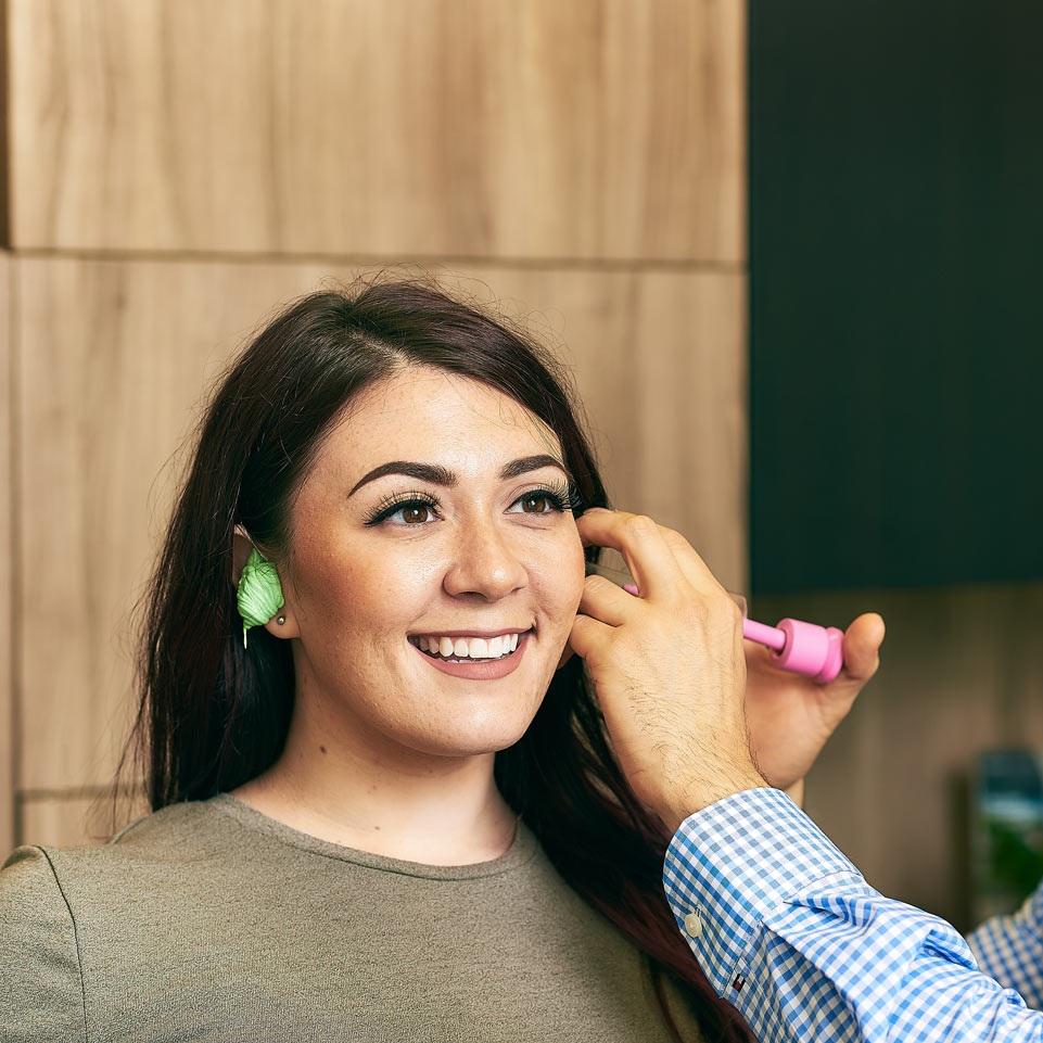 Neil Fine making molds of a patients ear