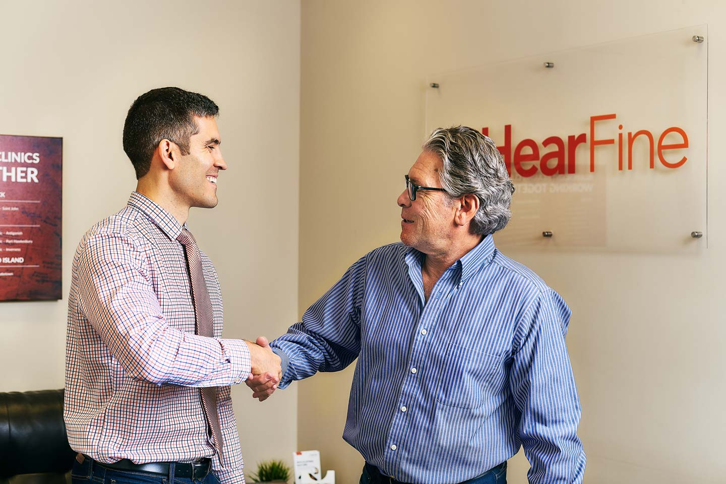 Neil Fine, Ottawa Audiologist and Owner of Hear Fine, shakes the hand of a happy customer.