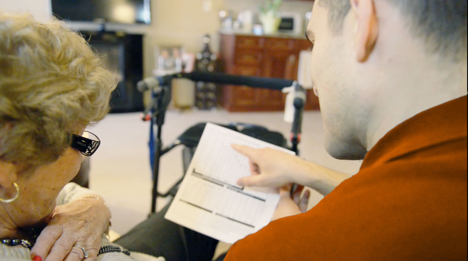 Patient getting his hearing testing in his own home by an Audiologist.