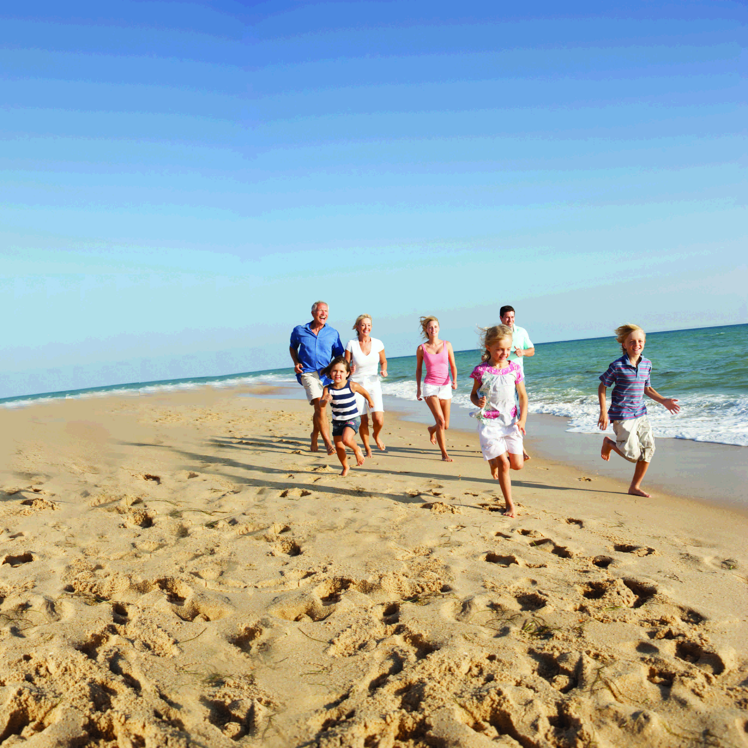 family running on beach (lo res).jpg