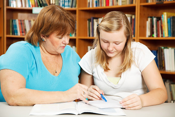 Canva---Mother-Helps-Teen-with-Homework-588w.jpg
