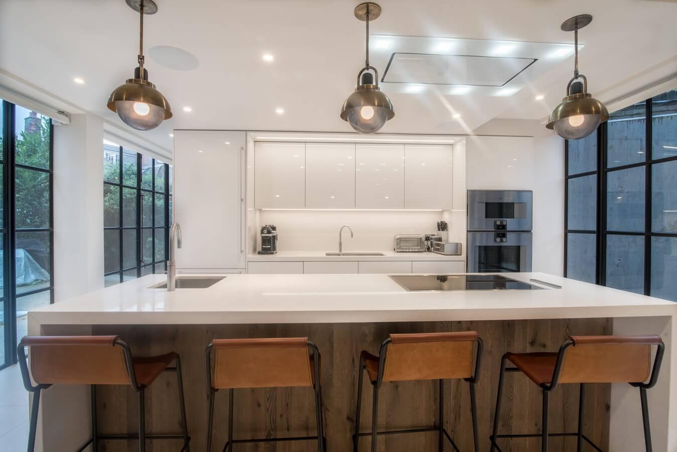High-Gloss-White-German-Kitchen-With-Bulkhead.jpg