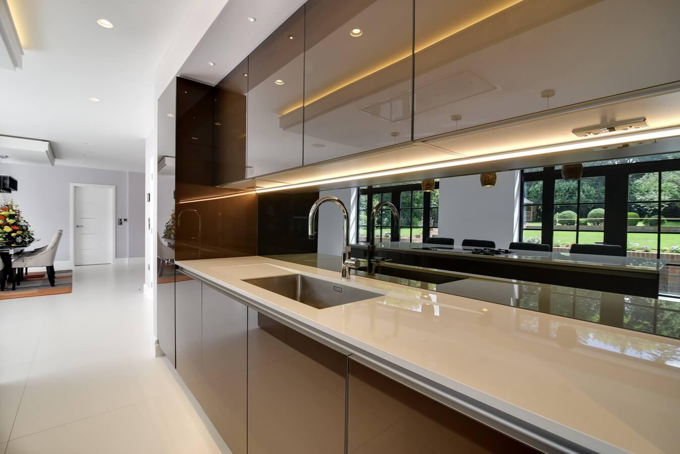 modern-kitchen-glossy-glass-handleless-dekton-worktop.jpg