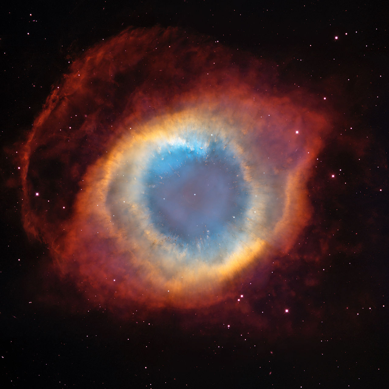 The Eye of God - NGC 7293  seen through several visible filters by  Hubble Space Telescope .