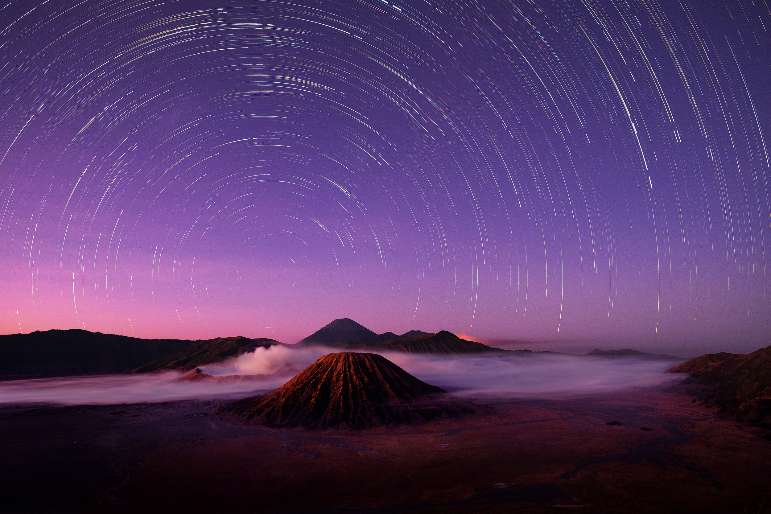 Stars Above Bromo   We arrived on the edge of the crater overlooking the caldera at around 3am and the sky was full of really bright stars. This image uses the intervalometer on the Fuji X-T1 to show the stars movement across the sky for a little over an hour as the sky went from complete darkness to pale pre-dawn light. If you notice on the edge of the crater to the right of centre there's a red/orange glow which was visible even in complete darkness. There are a couple of very active volcanos in this image, so I assume it's some kind of lava glow from a crater