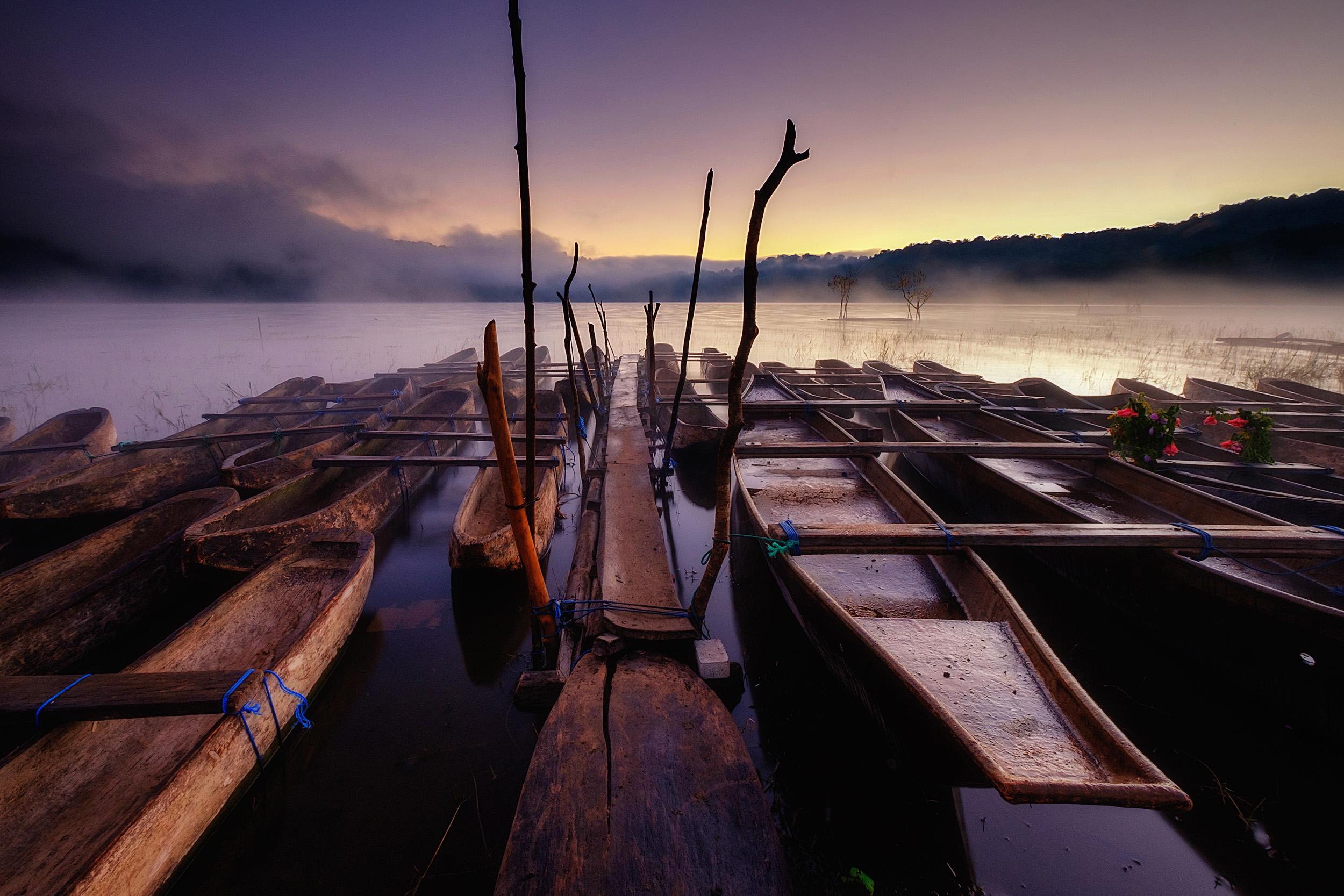 Tamblingan   Dugout canoes at Tamblingan lake at dawn, Central Bali.