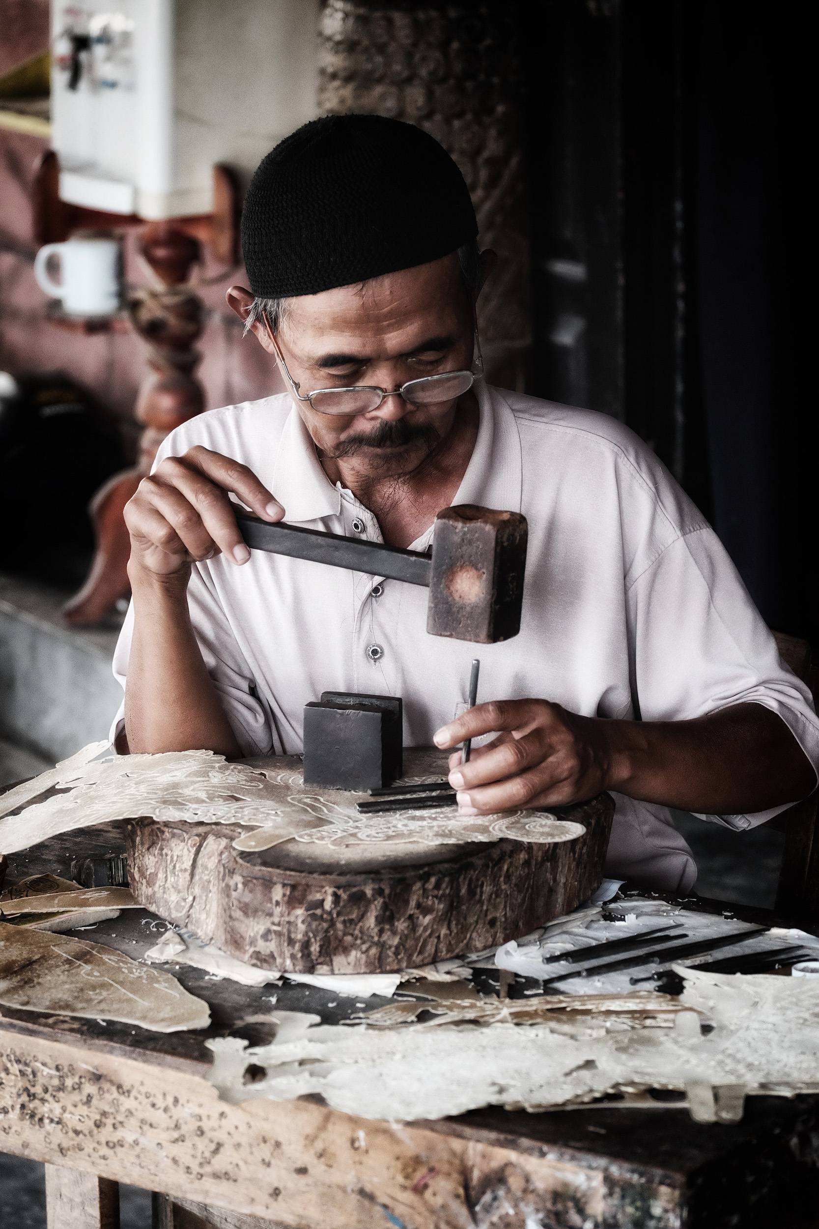 The Puppet Maker   A man makes shadow puppets for wayang kulit performance at the palace of Yogyakarta, Java.